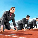 businessmen on start line of running track low angle view