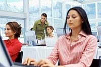 five businesswomen working in a training class