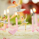 close-up of ballerinas on a birthday cake