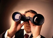 close-up of a man looking into binoculars