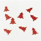 Red christmas tree shapes on white background (soft focus)
