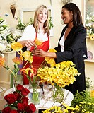 Woman shopping for flowers in floral shop