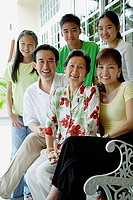 Three generation family smiling at camera