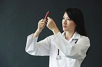 Female doctor preparing syringe