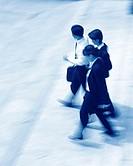 Three executives walking (motion blur), (blue tone)