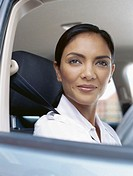 close-up of a businesswoman sitting in a car