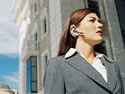 close-up of a businesswoman wearing a hands free device