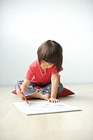 Young girl drawing on drawing pad.