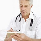 male doctor writing a prescription on a note pad