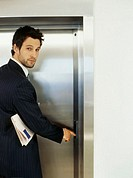 Portrait of a businessman using an elevator
