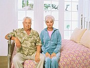Portrait of a senior couple sitting on the bed