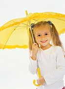 Portrait of a young girl holding a umbrella