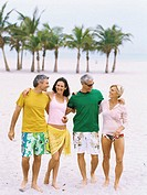 Mature people standing on the beach
