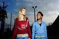 Low angle view of two teenage girls standing together