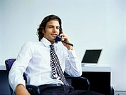 Close-up of a young businessman talking on the phone