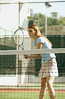 Woman holding tennis racket, playing tennis