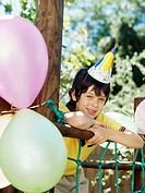 Portrait of a boy wearing a party hat