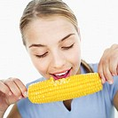 Close-up of a teenage girl (15-17) eating a corncob