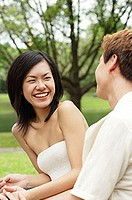 Woman smiling at man sitting next to her
