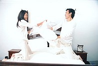Couple pillow fighting