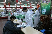 PHARMACY, CHINA<BR>Photo essay for press only.<BR>Chinese pharmacy, Beijing. Taking blood pressure with a sphygmomanometer.