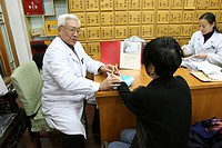 MEDICINE IN CHINA<BR>Photo essay for press only.<BR>Chinese medical consultation. Pulse taking. Traditional Chinese medicine, materia medica. China.