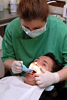 WOMAN RECEIVING DENTAL CARE<BR>Photo essay from dental office.