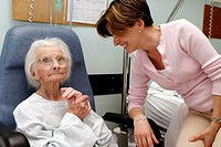 VISIT, ELDERLY HOSP. PATIENT<BR>Photo essay from hospital.<BR>Geriatrics unit. A 95-year-old patient receives a family visit.