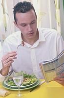 MAN EATING SALAD<BR>Model.