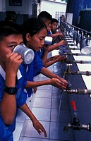 ASIAN CHILD<BR>Photo essay for press only.<BR>School children drinking and washing their hands, Thailand.
