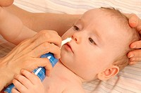 CHILD USING NOSE SPRAY<BR>Model.<BR>6-month-old baby boy.