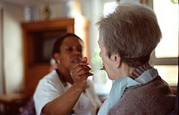 HOME FOR THE AGED<BR>Photo essay in nursing home for the elderly in Paris. Nurse´s aide and resident. Dependency.