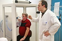 BREATHING, PLETHYSMOGRAPHY<BR>Photo essay at La Louvière clinic, France. Patient and technician.<BR>Pneumology department. Pulmonary function test. St...