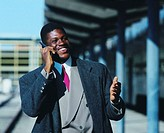 businessman talking on mobile phone and smiling