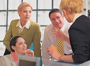 business executives talking in office