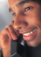 close-up of a man talking on telephone