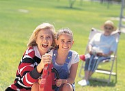 a woman laughing with her daughter in a park