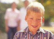 portrait of a young boy (10-12) smiling