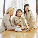 three businesswomen discussing in an office