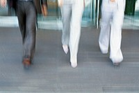 low section view of three business executives walking together