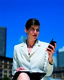 Young businesswoman holding a mobile phone