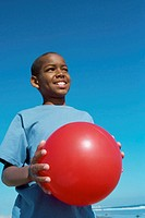 low angle view of a boy holding a ball
