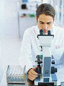 male scientist using a microscope in a laboratory