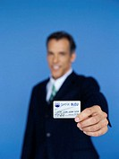 portrait of a businessman holding a credit card