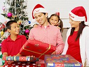 portrait of a family with christmas gifts