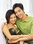 portrait of a young couple embracing and smiling