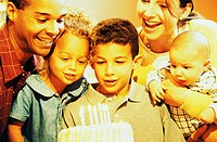 Parents with their two sons and a daughter celebrating a birthday