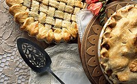 High angle view of pies with a slotted spoon