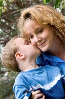 Close-up of a boy kissing his mother