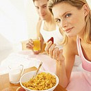 Woman having breakfast in bed with her partner